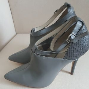Gray booties with buckle at ankle